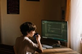 Young boy in front of computer programming